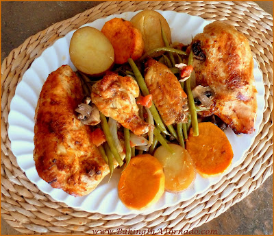 One Pot Chicken Dinner: Chicken pieces of your choice, veggies and potoes cook in one pot in the oven for an easy and flavorful dinner | Recipe developed by www.BakingInATornado.com | #recipe #dinner