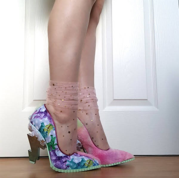 wearing pink tulle star socks with unicorn shoes with pink rainbow fluffy detail and lightning bolt heel