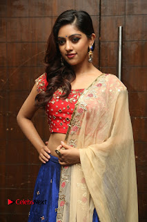 Anu Emmanuel sexy navel in lovely Red Choli Blue Ghagra at Manju Audio Launc