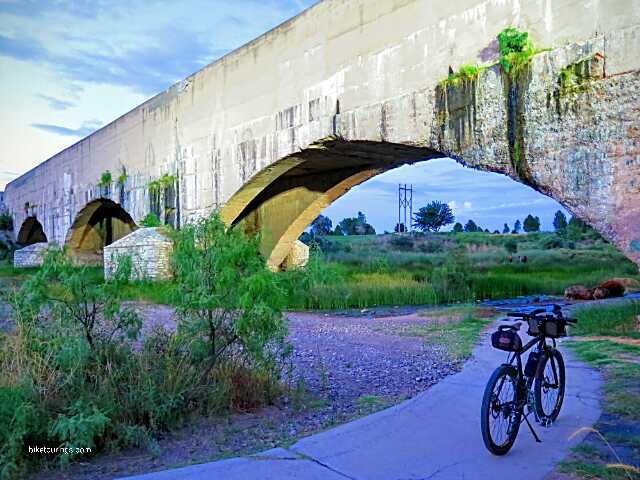 Picture of mountain bike on path with Pecos River Flume, Carlsbad, New Mexico