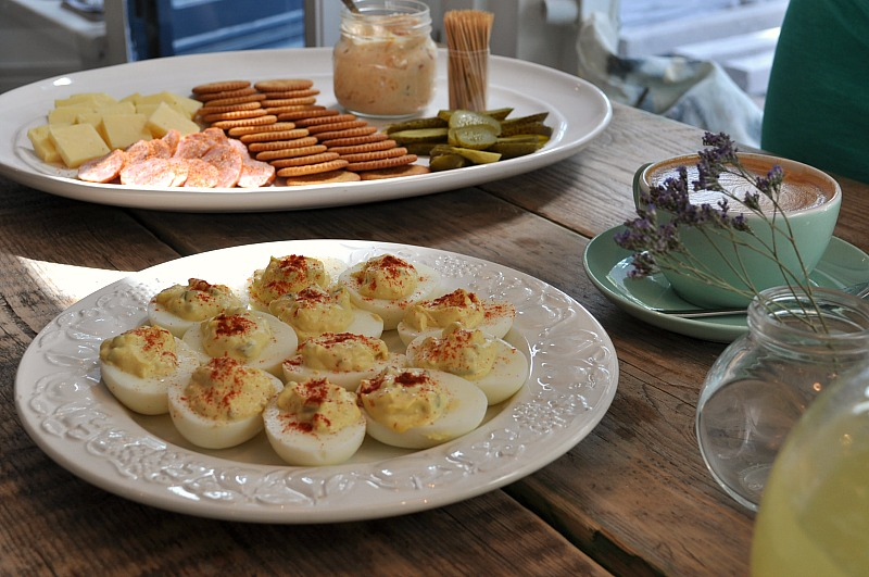 Full brunch with pickles and devilled eggs