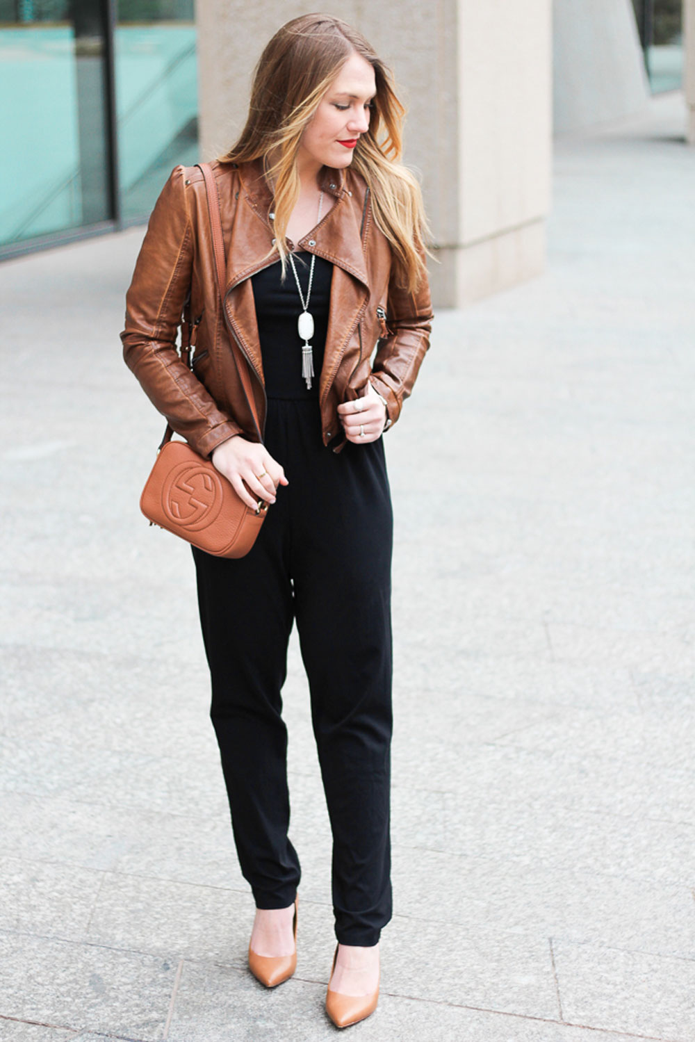black jumpsuit with moto jacket