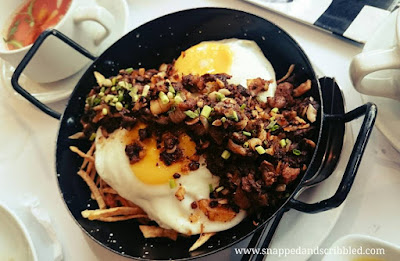 Sisig, Sausage and Egg on a Bed of Shoestring Potatoes at Tapella by Robert Spakowski
