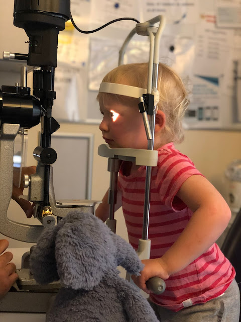 Toddler getting her scratched eye checked at Moorfield's eye hospital