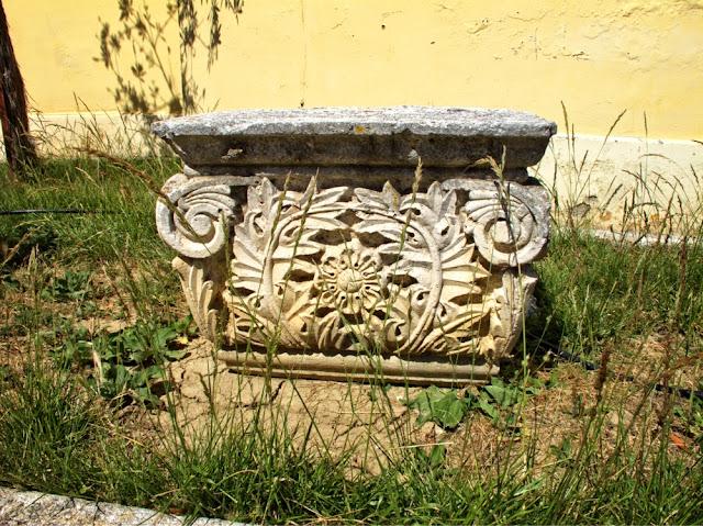 old stone flower pedestal photo by sue wellington
