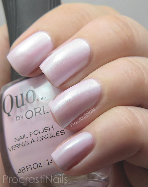 Soft pink nail polish with blue shimmer