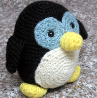 http://www.ravelry.com/patterns/library/amigurumi-howie-the-holiday-penguin
