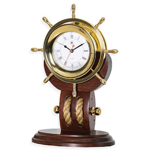 https://bellclocks.com/collections/bey-berk-international/products/brass-ships-wheel-clock-with-rope-on-teakwood-base-bey-berk-sq521t