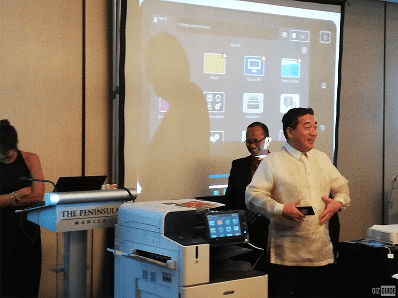 Fuji Xerox President Hideaki Kato demonstrating the mobile remote app functionality
