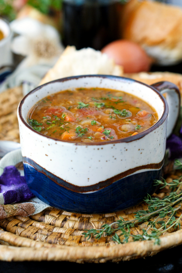 This Hearty Lentil Soup is comforting and filling, yet light and fresh.  It comes together easily using common pantry ingredients and lots of fresh vegetables! #soup #lentils
