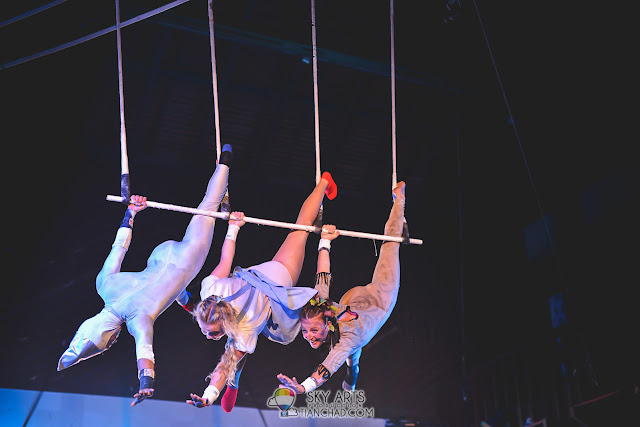 Jiwon, Nikki and Elisabeth together on top doing some tough acrobatic moves