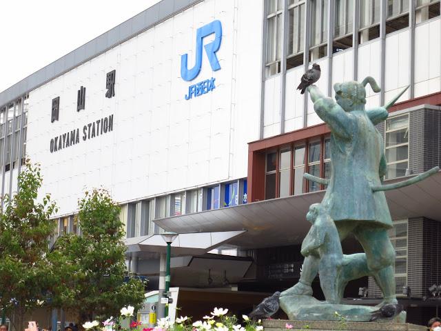 Momotaro peach boy statue of famous Japanese folklore. Okayama station. Tokyo Consult. TokyoConsult.