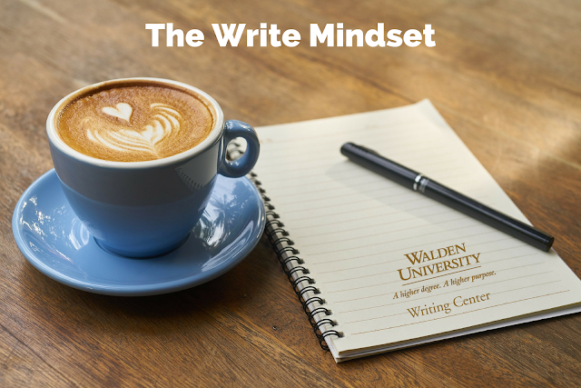 "A fancy latte next to an empty notebook with the text ""The Write Mindset"" overtop"