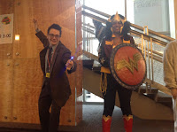 A man dressed up as Dr Who and a woman dressed up as Wonder Woman