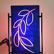 "Jerry Dreesen's Art Gallery: PAINTED GLASS ""NEON"" SCULPTURE  WITH BLACK METAL STAND AND BACK LIGHT 12"" X 18"""