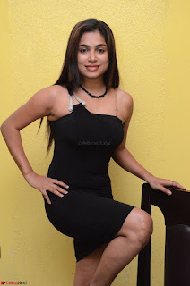 Vrushali Gosavi in strapless Short Black Dress At Follow Follow U Audio Launch 037.JPG