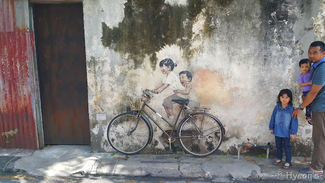 little children on a bicycle street art penang