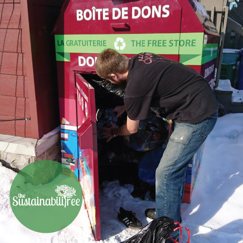 A coordinator empties out the Free Store Donation Bin
