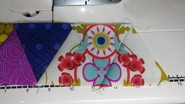 Fussy cutting and sewing triangles