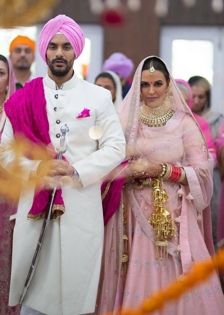 Neha Dhupia gets hitched with Angad Bedi in a hush-hush wedding