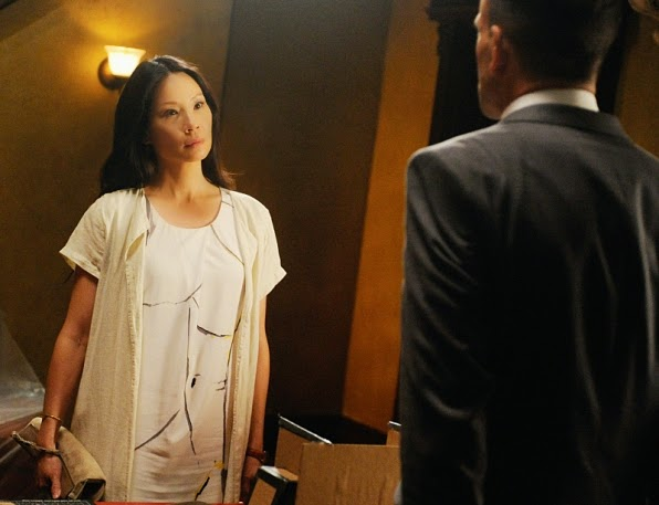 Lucy Liu as Joan Watson with Jonny Lee Miller as Sherlock Holmes in CBS Elementary Season 3 Episode 1 Enough Nemesis To Go Around