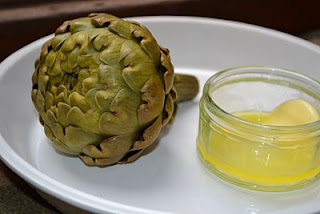 Globe artichoke with melted butter