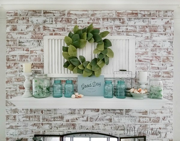 shutter, magnolia wreath, antique mason jars and beach glass