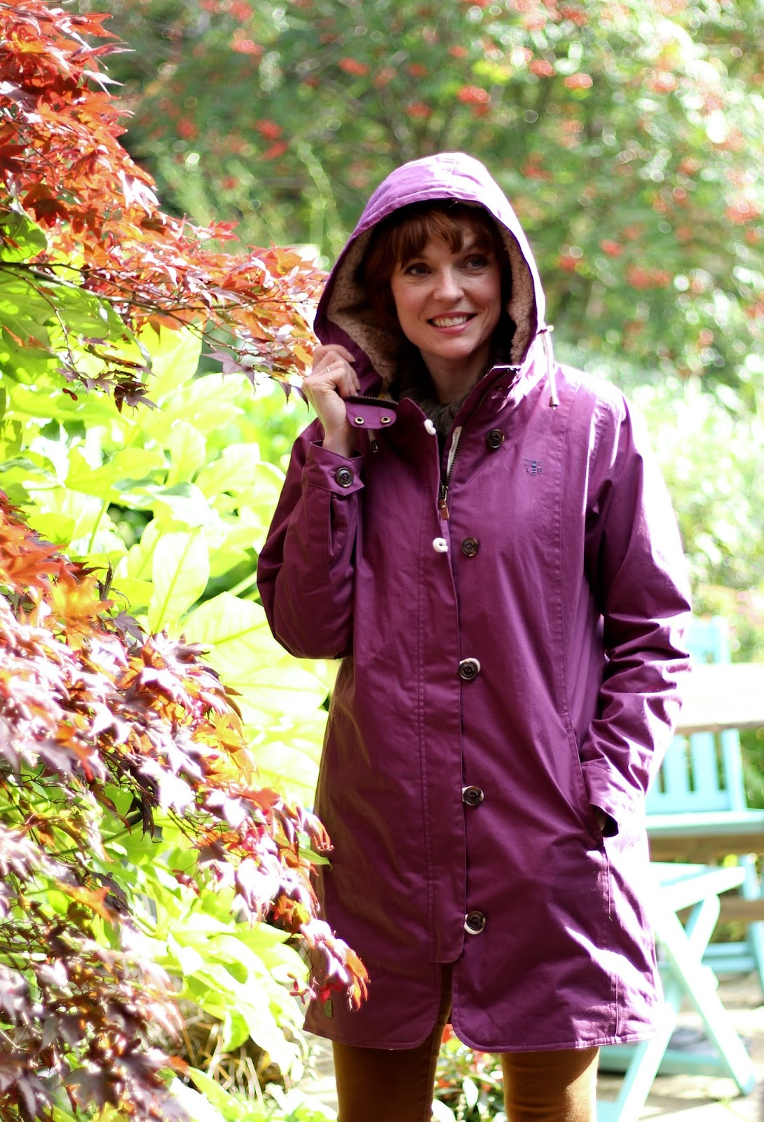 Fake Fabulous | Plum waterproof lighthouse coat, tobacco jeans and walking boots.