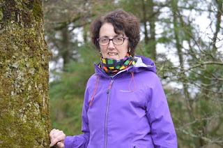 Nuala owner at Tawnylust Lodge standing at a tree Leitrim