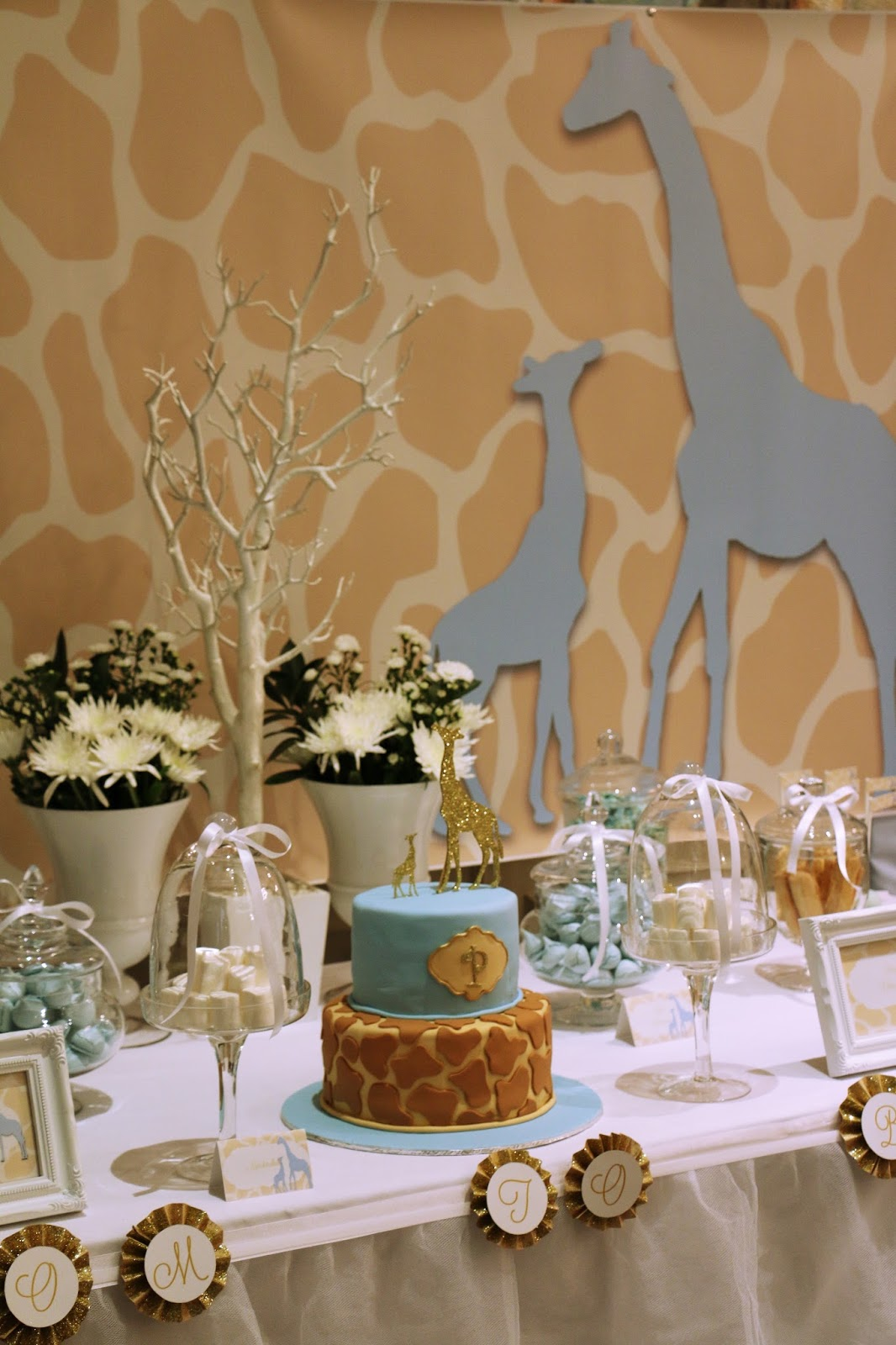 We Used A Silhouette Of A Mommy Giraffe And Itu0027s Baby Through The Artwork  And Used A Blue, White And Glittery Gold Color Scheme.