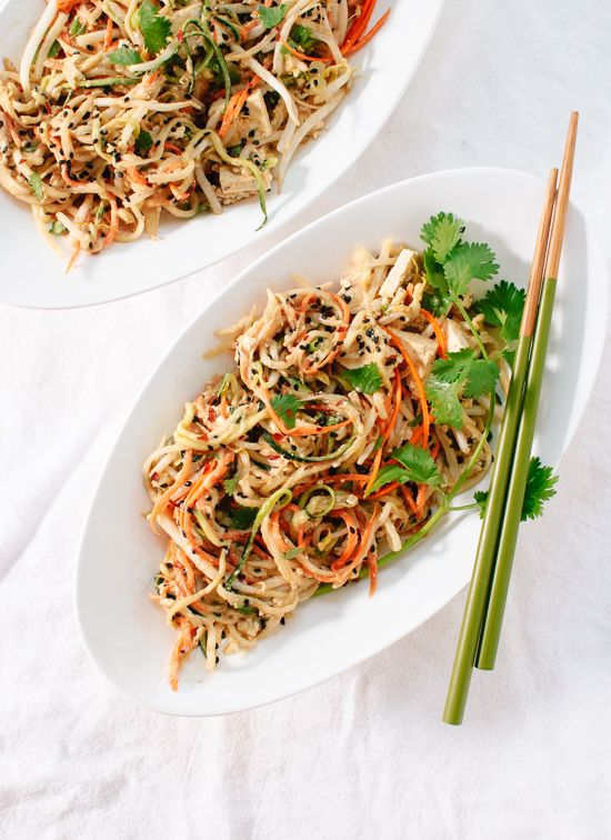 A light, healthy take on pad Thai that uses raw vegetable noodles instead of rice noodles! Daikon, zucchini and carrot ribbons tossed in savory peanut sauce makes this salad-y dish irresistible. This meal is gluten free and easily made vegan. Less