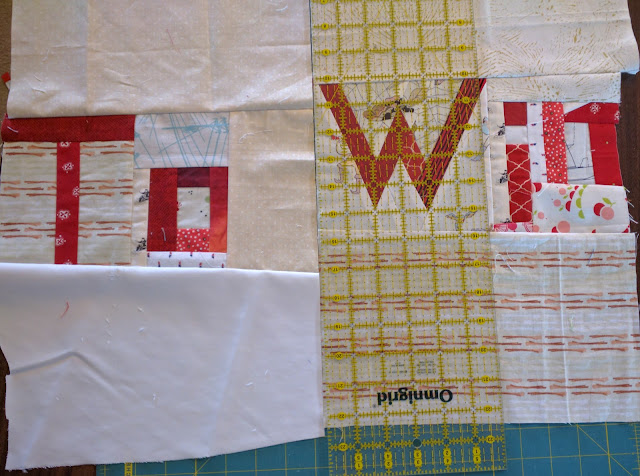 Use rulers to space the pieced-fabric words.