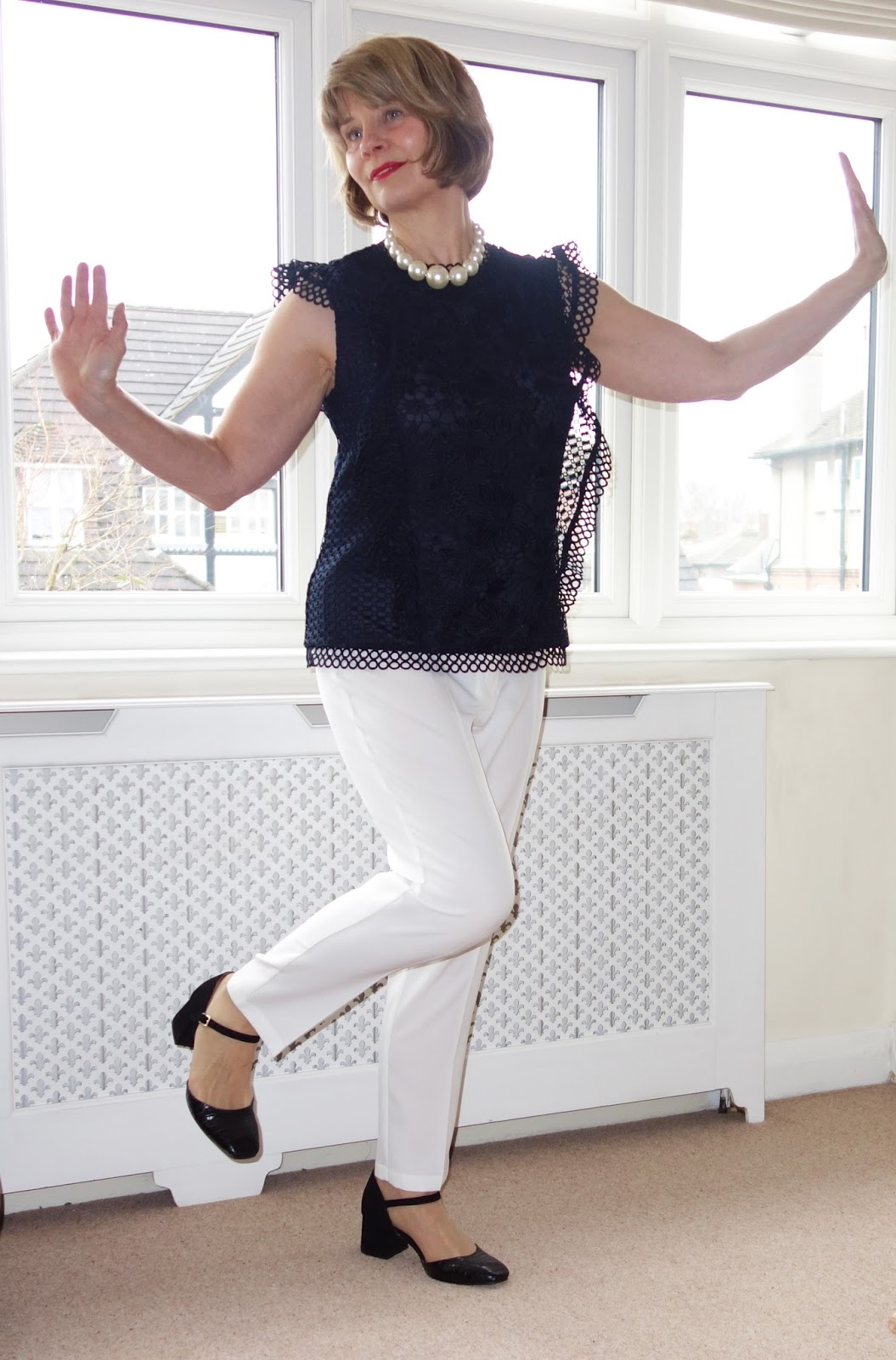 Gail Hanlon UK blogger in navy lace top and white trousers