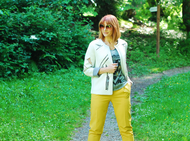 Dressed for a cool British summer: White scuba jacket, grey rock t-shirt, yellow tailored trousers | Not Dressed As Lamb