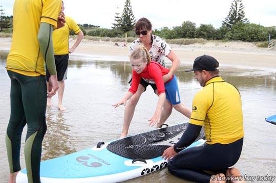 Centre: Liv Fountain, 10, Clive, who has cerebral palsy - Flight Centre Foundation Halberg Disability Water Sports Day at Waimarama Beach, Waimarama. photograph