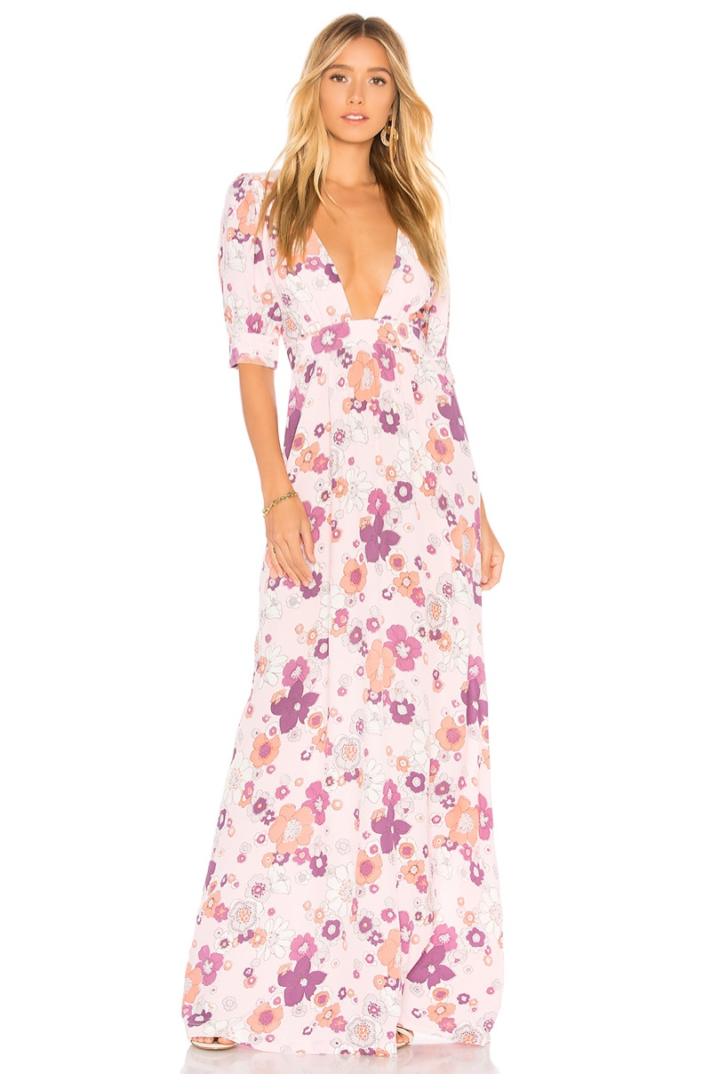 This blossom print maxi dress channels 1970's vibes with a plunging neckline.