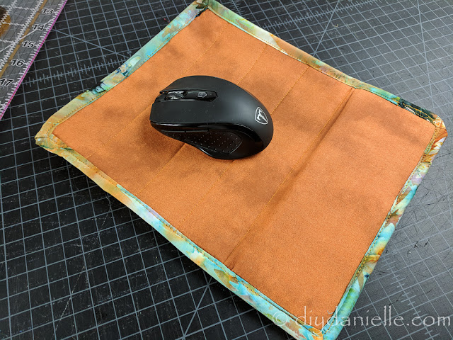 Mousepad with wrist rest.
