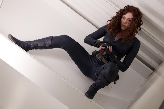 Scarlett Johansson as Black Widow, lying on the floor legs spread, in Iron Man 2 movieloversreviews.filminspector.com