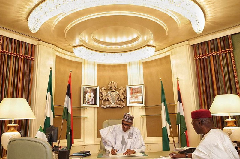 President Buhari poses in his office, writes National Assembly