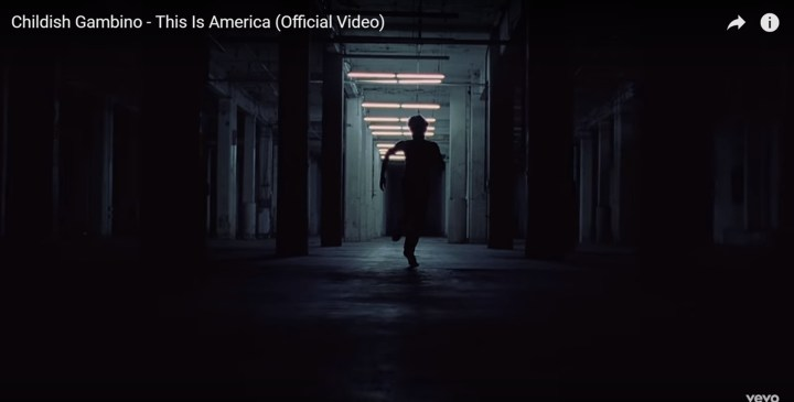 Childish Gambino's This is America - Easter egg - His pants and shoes are indistinctive as he runs in the darkness. Without it, Childish Gambino is a black man once more in the real world. A world that does not appear as bright now.