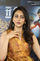 Rakul Preet Singh smiling Beautyin Brown Deep neck Sleeveless Gown at her interview 2.8.17 ~  Exclusive Celebrities Galleries 085.JPG