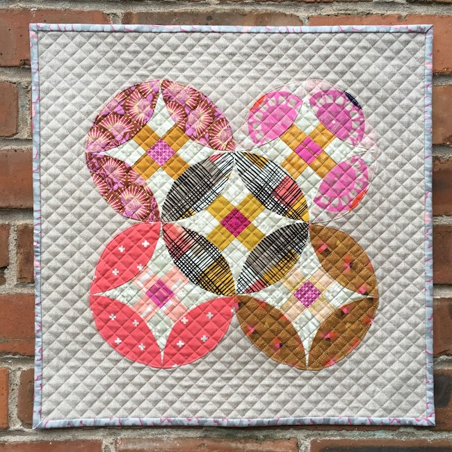 orange peel quilt on brick wall