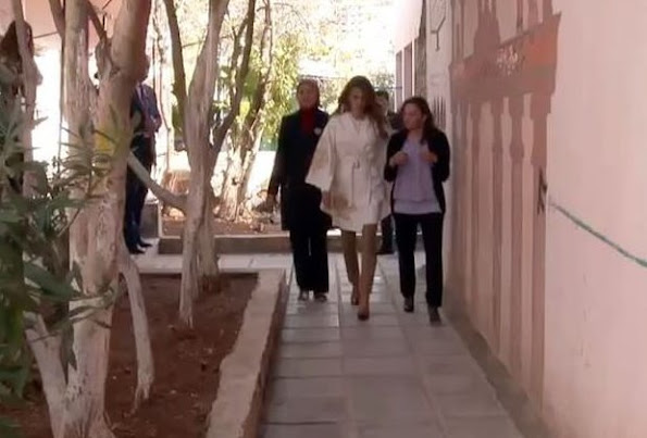 Queen Rania of Jordan wears Valentino coat and trousers, Valentino Rock Pumps and Valentino rock handbags