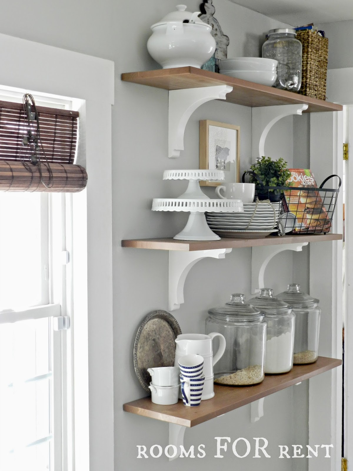 Decorating with glass canisters in the kitchen (Photo via Rooms FOR Rent) | anderson + grant
