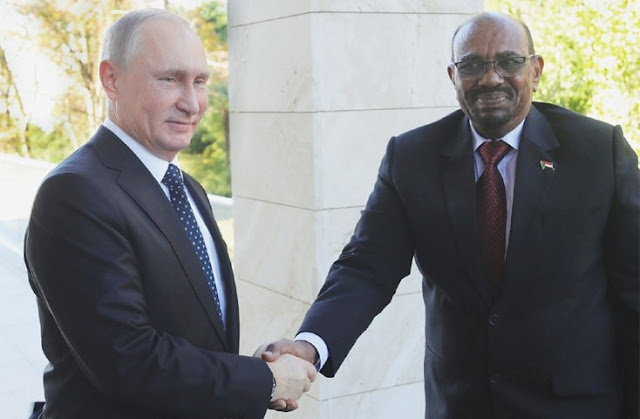 Sochi: Russian President Vladimir Putin shakes hands with his Sudanese counterpart Omar al Bashir during a meeting on Thursday.—AFP