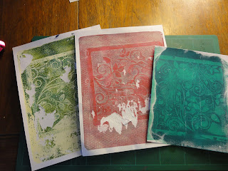 Gel plate prints using the leafy swirl stencil, light green, red and dark green/blue