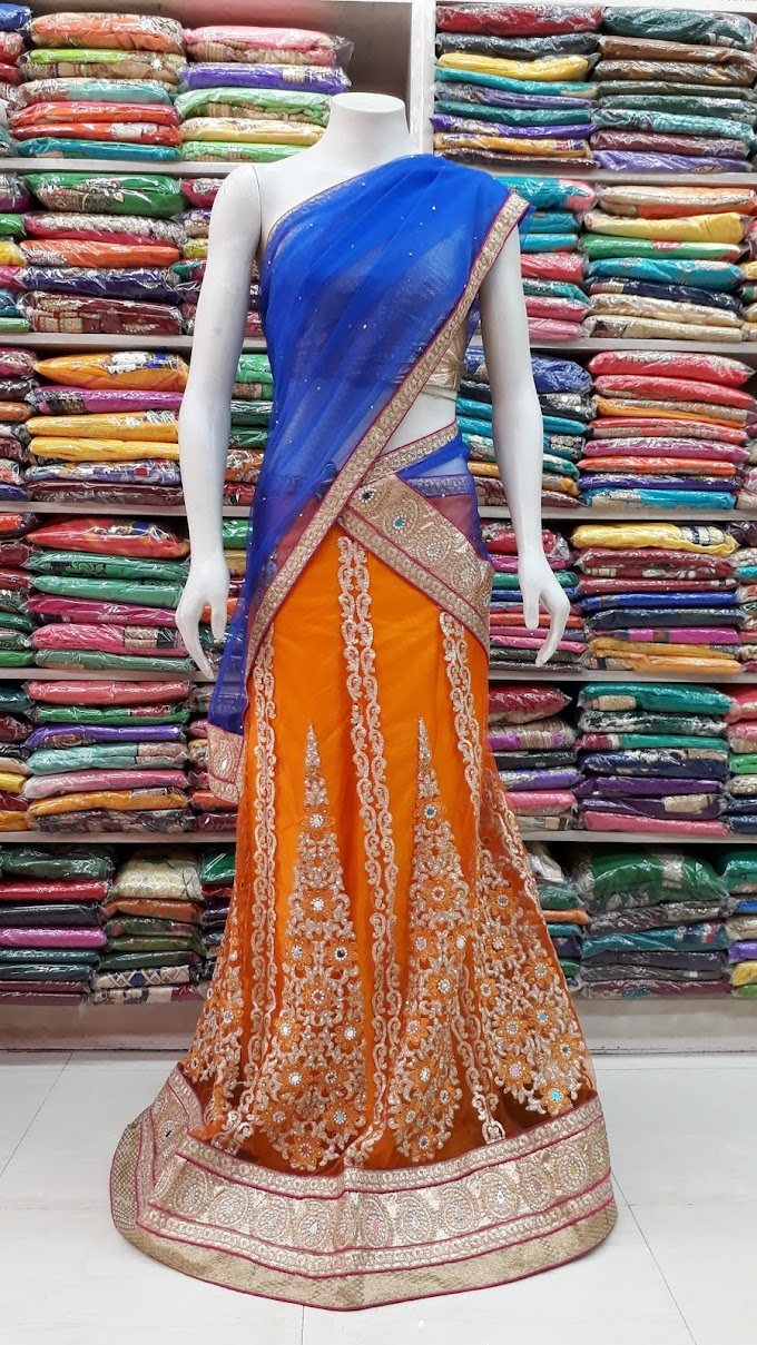 golden and blue party net fabric lehenga with contras blue color dupatta