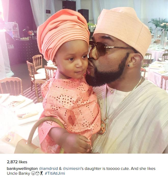 "Aww! ""Uncle"" Banky W poses with Dr. Sid's daughter"