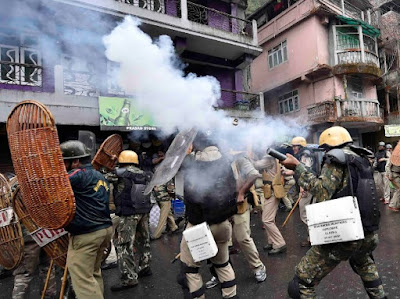 Security personnel fires tear gas