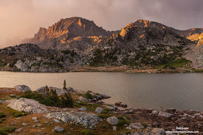 Storm clouds part to reveal Fremont Peak over Island Lake in the Wind River Range of Wyoming, USA.